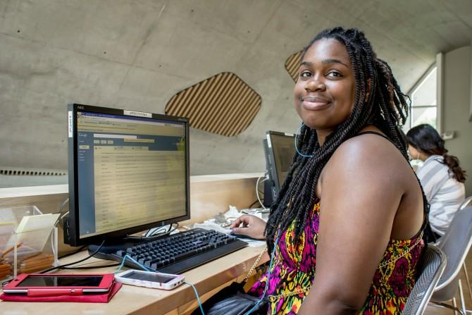 Customer at computer at Jasper Place.