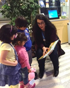 EPL staff reading to children at a welcome event for Syrian Refugees at Edmonton's city hall.
